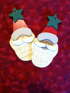 Wooden ornament hand cut and hand painted.